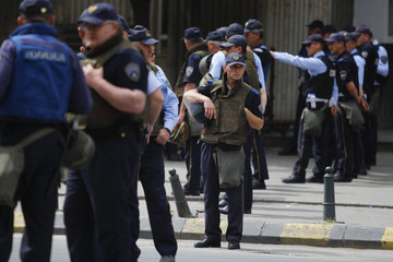 Macedonian police stand guard near the parliament building in Skopje