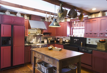 Kitchen in colonial house with red cabinets