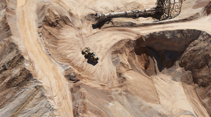 USA, Texas, aerial view of sand mine near San Antonio with a grader moving sand