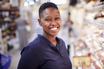 Black woman smiling in grocery store