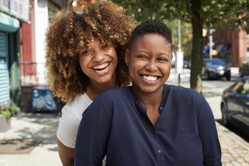 Portrait of female friends smiling