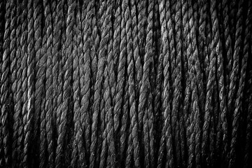 reel black synthetic thread. textile concept. abstract background