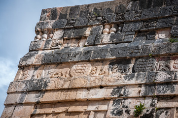 Detail of the carvings on a stone wall at the Temple of the Jaguars in Chichen Itza, Yucatan Peninsula, Mexico.