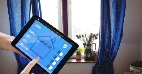 Hands using smart home application on tablet PC