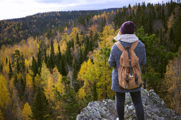 Caucasian woman backpacking in autumn landscape