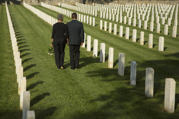 Black couple walking in military cemetery