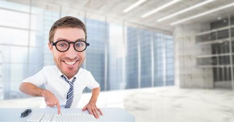 Digital composite image of happy nerd using computer keyboard