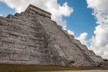 Close up perspective of El Castillo (The Kukulkan Temple) of Chichen Itza, Mayan stepped pyramid in Yucatan, a modern wonder of the world and an UNESCO world heritage site.