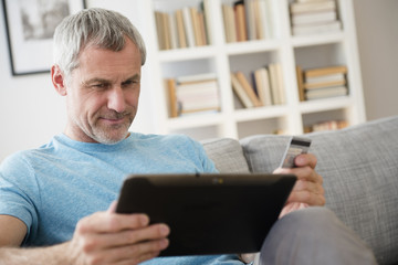 Older Caucasian man online shopping with digital tablet