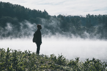 Man standing in foggy landscape