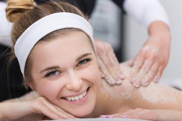Woman Getting Exfoliating Salt Scrub Massage At Beauticians