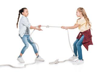Girls play tug of war