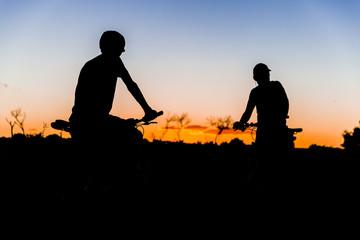 bikers taking a break for sunset