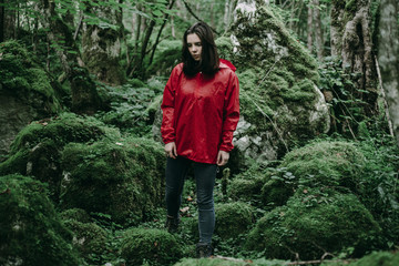 Caucasian woman standing in lush forest