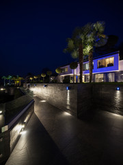 Exterior of luxurious modern villa, night scene
