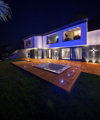 View of modern villa with pool in the night