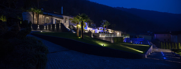 Exterior view of a modern luxury villa, nocturnal scene