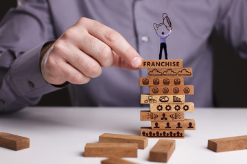 The concept of technology, the Internet and the network. Businessman shows a working model of business: Franchise