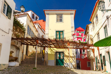 The typical street in Alfama, the oldest district of the Old Town, Lisbon, Portugal