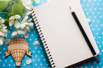 Open blank journal with flowers