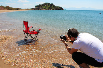 a photographer on the beach taking stock pictures