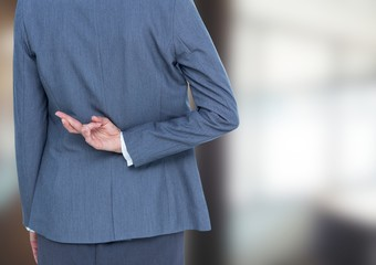 Blurred background. Office, woman with her fingers crossed