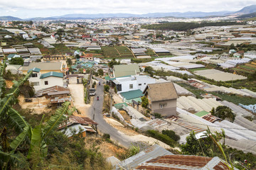 Green Houses Spread Across The Mountain Village Of Da Lat City In Vietnam