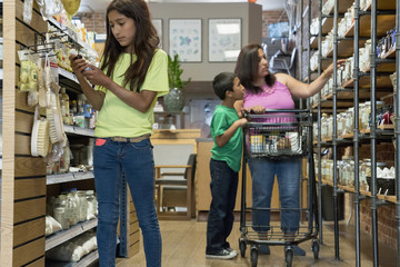 Hispanic family browsing in nutrition store