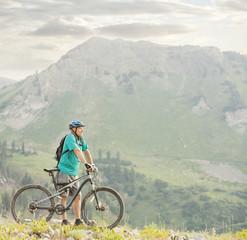 Caucasian man standing with mountain bike