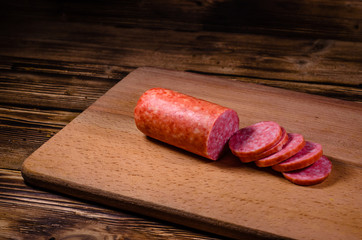 Sliced salami sausage on cutting board