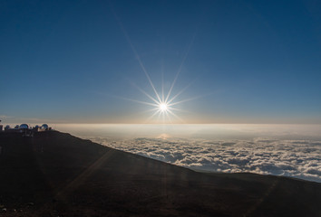 Setting sun viewed from the top of Haleakala crater on Maui, Hawaii