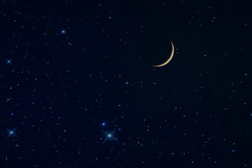 the new rising moon in the night sky and stars