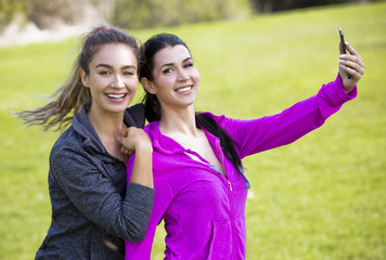 two fit women taking selfie together