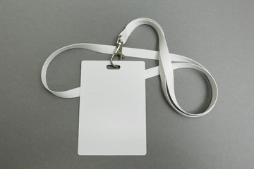 Businessman name card on a lanyard. Identification tag isolated on gray background. Blank ID card.