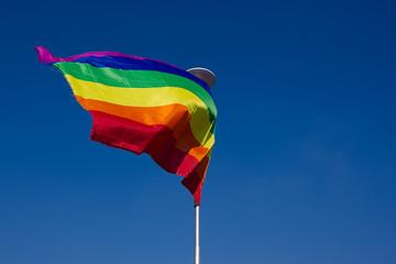 LGBT flag waving on wind.