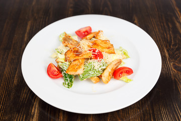 Plate with fresh caesar salad with chicken