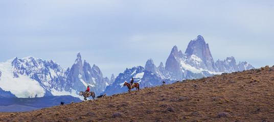 Gaucho riding against the background of Mount Fitz Roy, Patagonia, Argentina