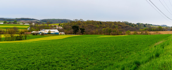 Pennsylvania countryside and farms in spring near Kutztown. Fields just starting to be plowed.