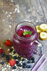Blueberry smoothie in a mason jar .