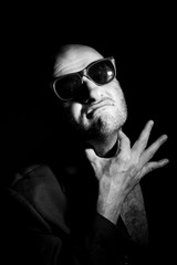 Portrait of gangster in sunglasses