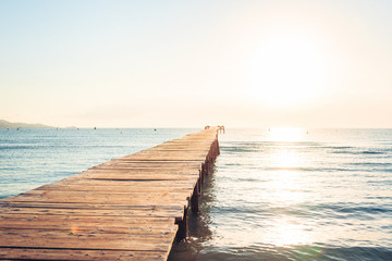 Lonely Pier On Mediterranean Beach