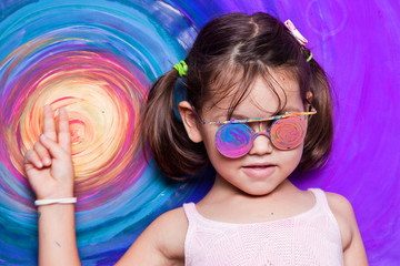 Little girl with painted glasses