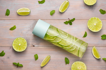 Detox Infused Water with Lime and Mint in Sports Bottle, with slices of lime.