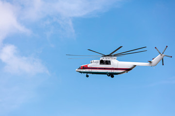 heavy cargo helicopter flying against sky