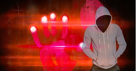 Hacker with hands in pockets standing by hand shape