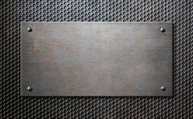 metal plaque with rivets over comb background