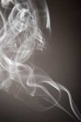 Smoke flows from an aromatic stick