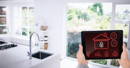 Hands using smart home app in kitchen