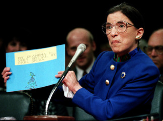 "US Supreme Court nominee Ruth Bader Ginsburgh holds up a drawing of herself with the words ""My Grand.."