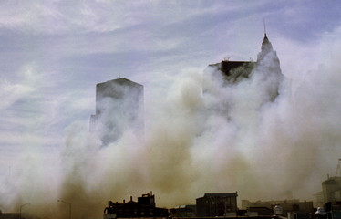Thick brown smoke covers much of the Wall Street area of New York City as a fire destroyed the histo..